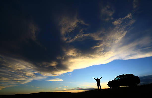 Happy Traveller Beside His SUV Vehicle stock photo