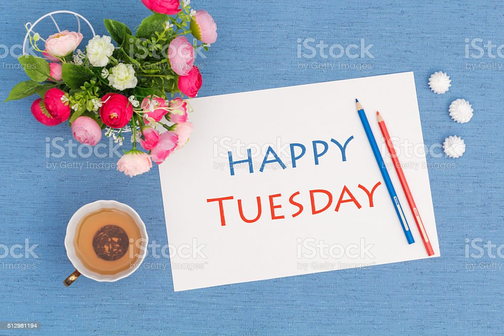 Happy Tuesday, croissants with green tea and flowers stock photo