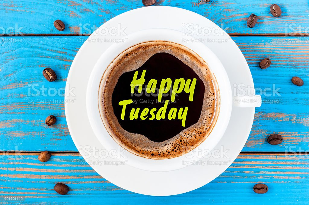 Happy Tuesday inspiration wish on top view cup of coffee stock photo