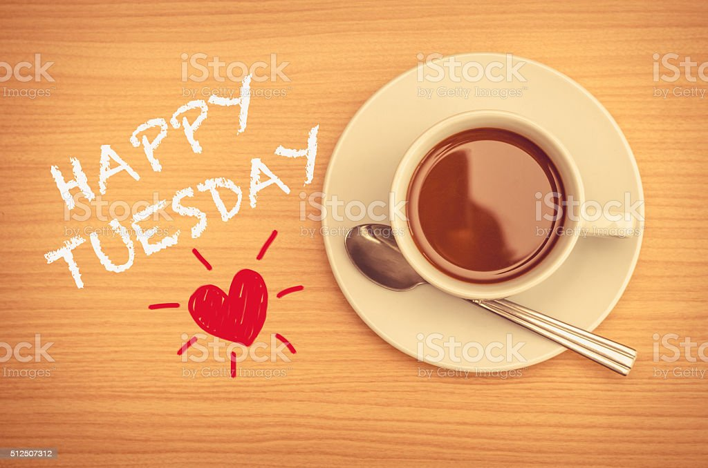 Happy Tuesday with coffee cup on table stock photo
