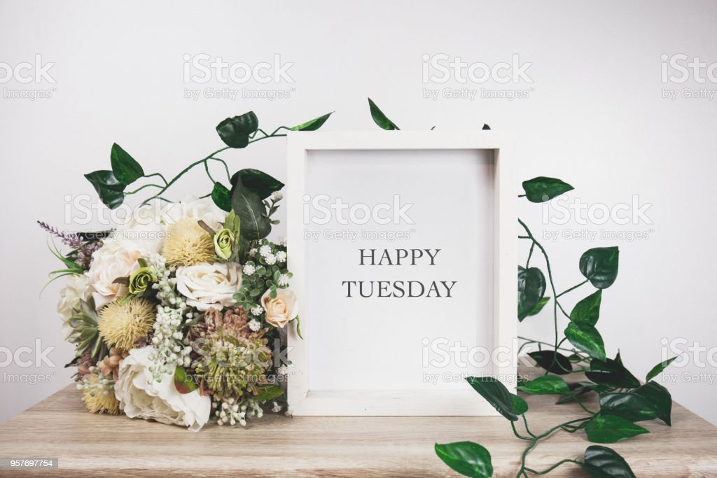 Happy Tuesday word with White frame mockup stock photo
