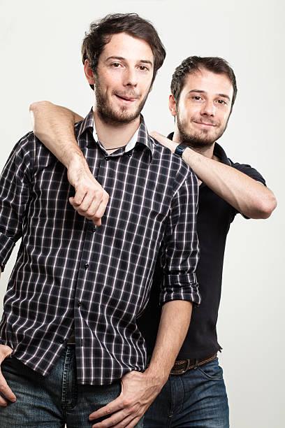 happy-einzelbetten - siamesische zwillinge stock-fotos und bilder
