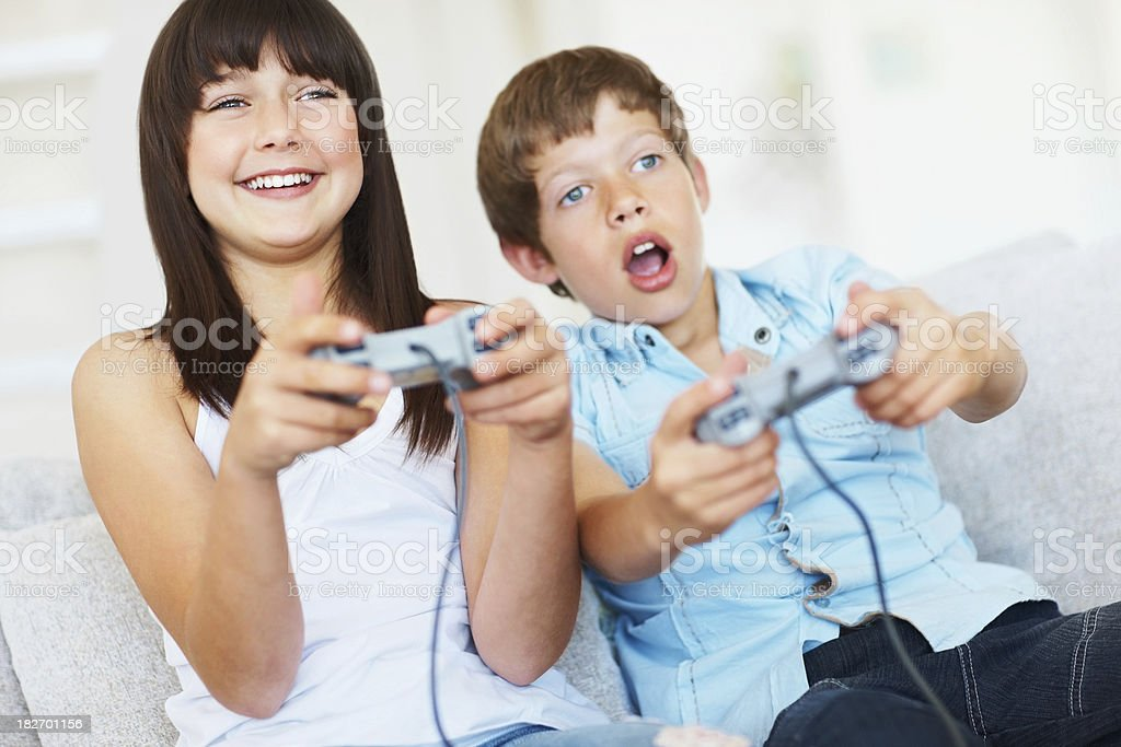 Happy two children playing games and having fun royalty-free stock photo