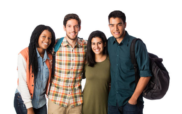 Happy university friends smiling at camera Four happy university friends standing side by side, embracing and smiling at the camera. medium shot stock pictures, royalty-free photos & images