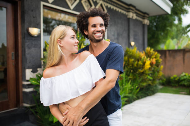 Happy vacationers enjoying each other and weather stock photo