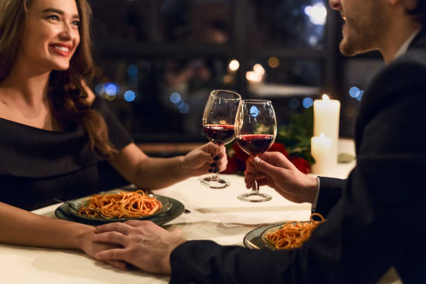 Happy Valentine day concept Happy couple having romantic dinner in restaurant. Happy Valentine day concept date stock pictures, royalty-free photos & images