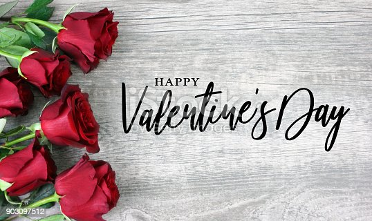 istock Happy Valentine's Day Calligraphy with Red Roses 903097512