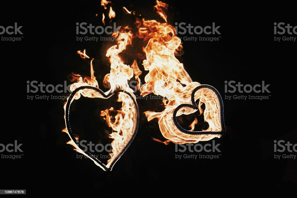 happy valentine's day card. two hearts shaped fireworks on black background, fire show in night. bengal fire burning heart. space for text. wedding or valentine concept. happy new year stock photo