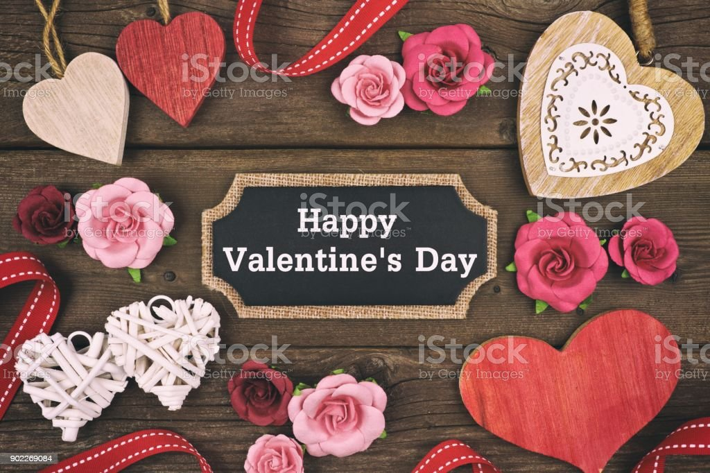 Happy Valentines Day chalkboard tag with frame of hearts and flowers stock photo