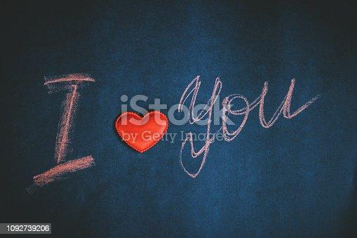 istock Happy Valentine's day, handwritten chalk inscription I love you 1092739206