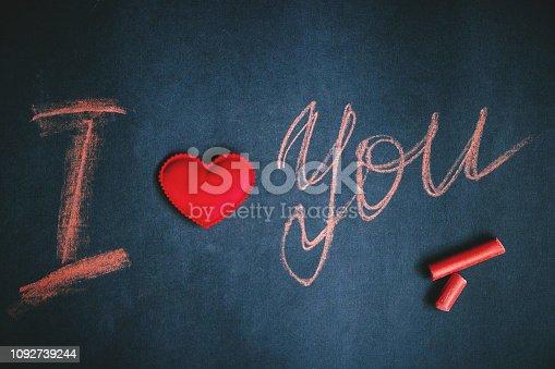 istock Happy Valentine's day, handwritten chalk inscription I love you 1092739244