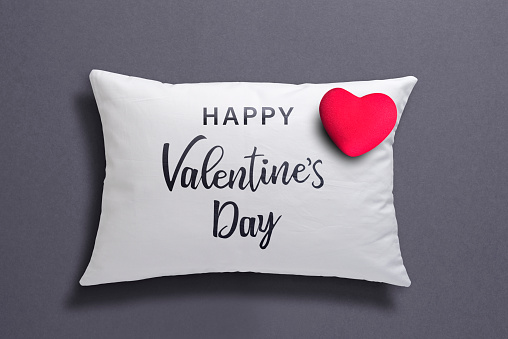 """Happy Valentine's Day"""" Message And An Red Heart Shape On White Cushion"""