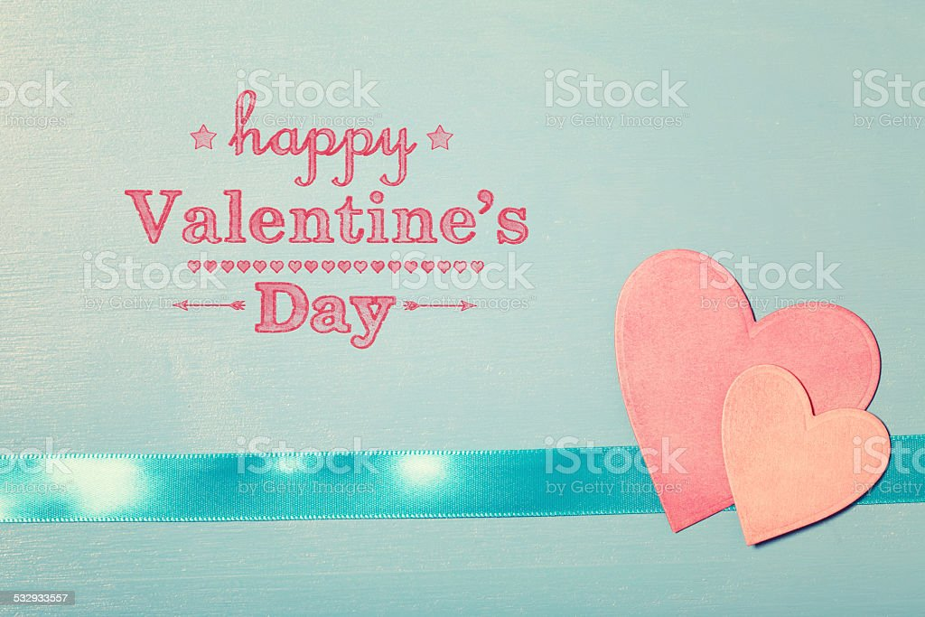 Happy Valentines Day message with pink paper hearts stock photo