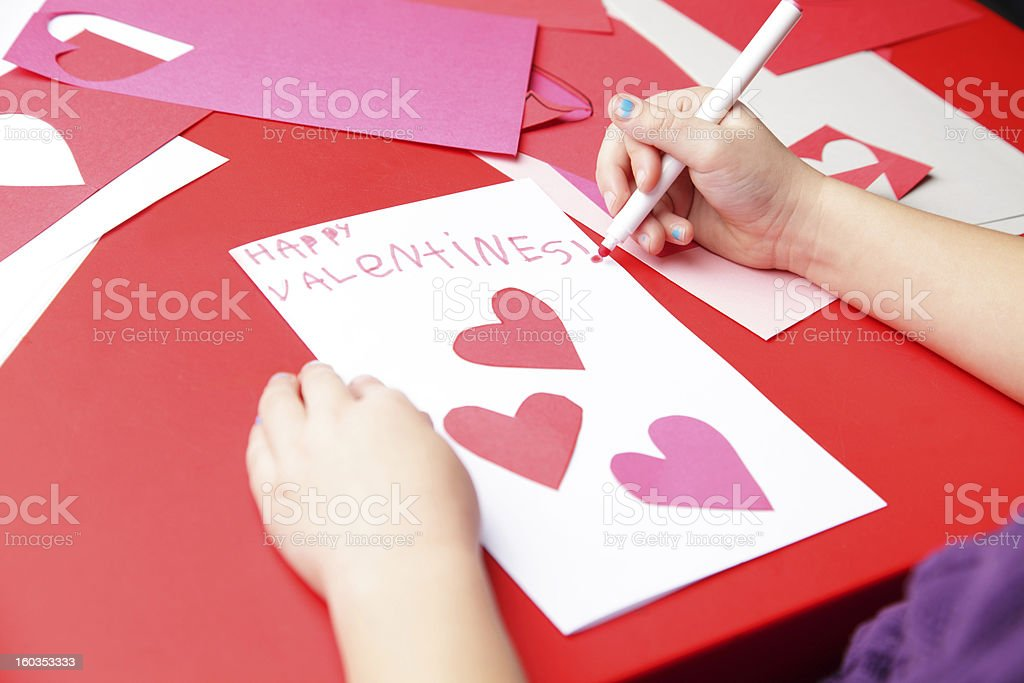 """Happy Valentine's Day A young girl makes the finishing touches to her """"Happy Valentine's!"""" card.   4-5 Years Stock Photo"""