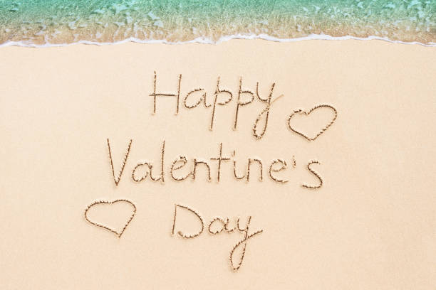 Happy Valentine's Day written on the tropical beach stock photo