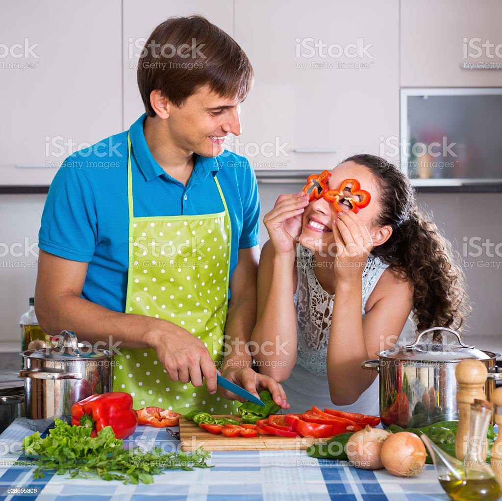 Happy vegeterian couple preparing soup stock photo