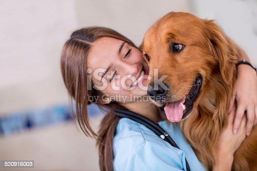 Happy vet hugging a beautiful a dog