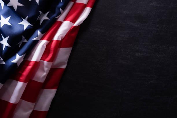happy veterans day. american flags veterans against a blackboard background. - fourth of july zdjęcia i obrazy z banku zdjęć