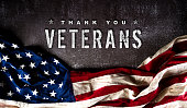 istock Happy Veterans Day concept. American flags against a dark stone  background. November 11. 1284024758