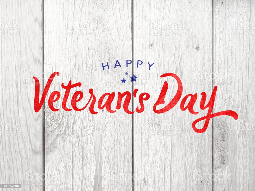 Happy Veteran's Day Typography Over Wood Background stock photo