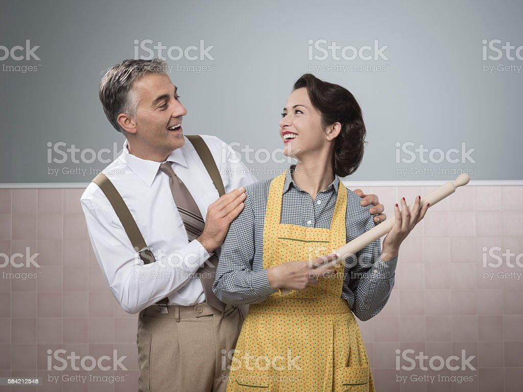 Happy vintage couple at home stock photo