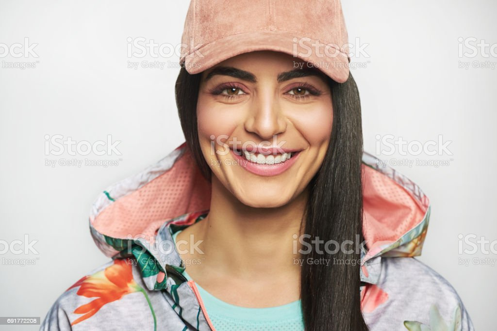 Happy vivacious woman with a beaming smile stock photo