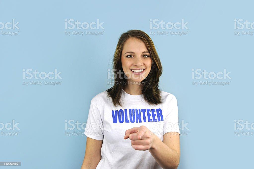 De voluntarios Feliz niña señalando en que - foto de stock