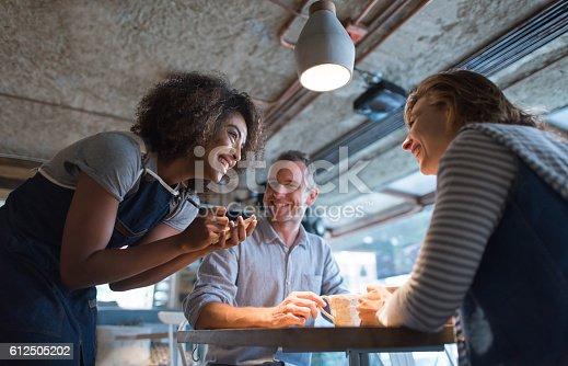 635812444 istock photo Happy waitress taking an order at a restaurant 612505202