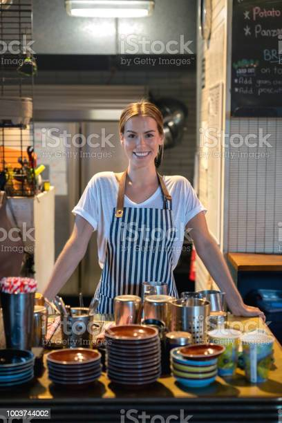 Happy waitress working at a cafe picture id1003744002?b=1&k=6&m=1003744002&s=612x612&h= yegmkknthfzy1jconwv092ngkovqrjipza08njuix8=