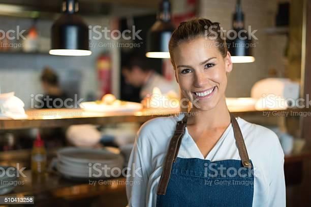 Happy waitress working at a restaurant picture id510413258?b=1&k=6&m=510413258&s=612x612&h=12i268puatjsznspcupgwkchtkcykvbhbwm9jq6rqfa=