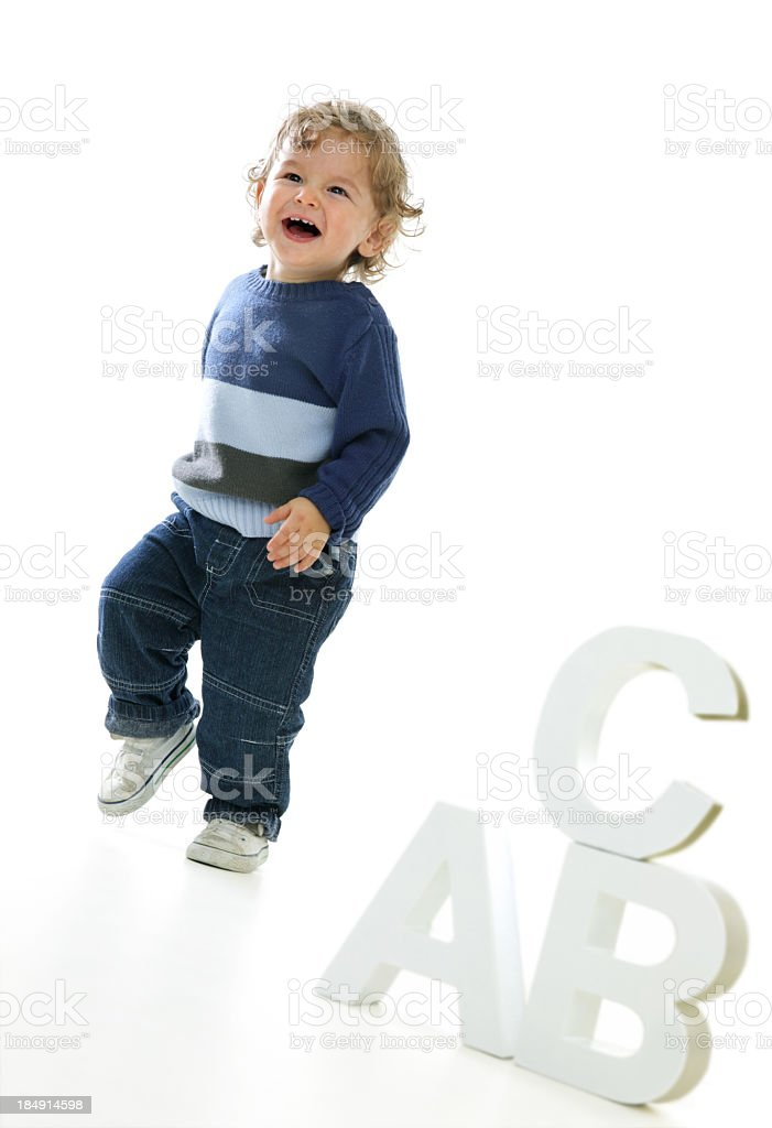 Happy walking baby Boy with his ABC royalty-free stock photo