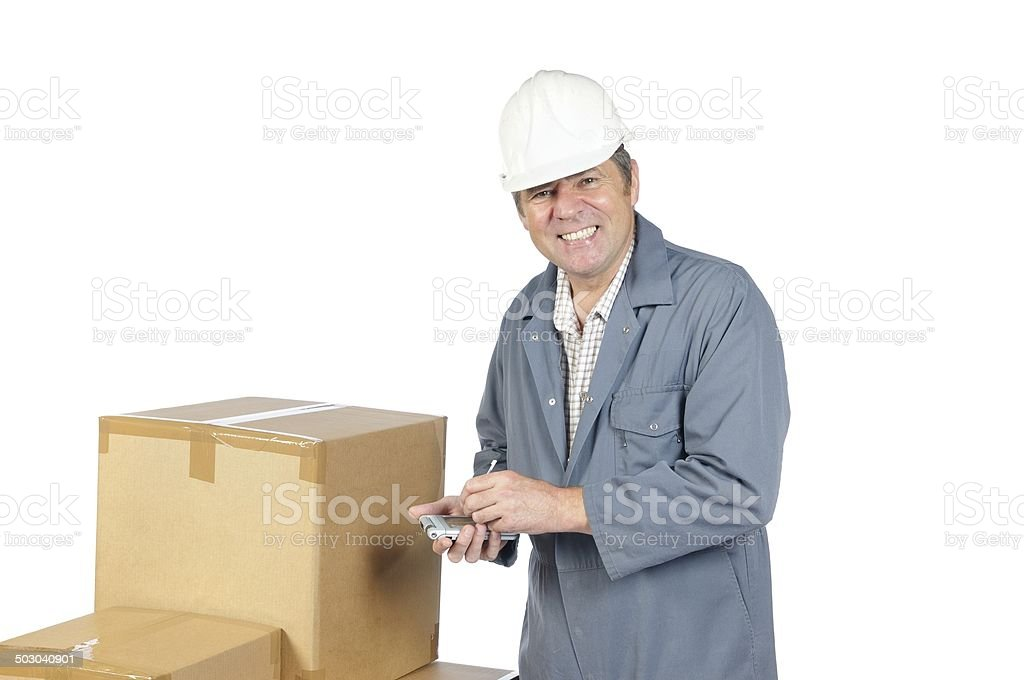 Happy Warehouse Man Cheking Some Boxes Using A PDA stock photo