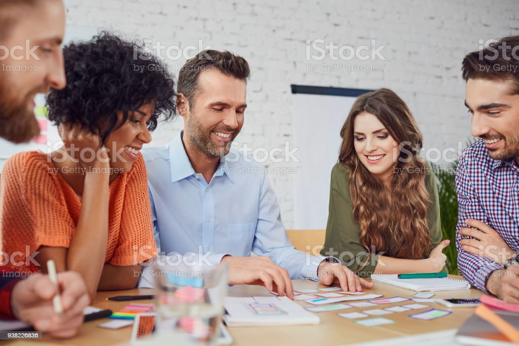 Happy web designers developing new web site layout in office stock photo