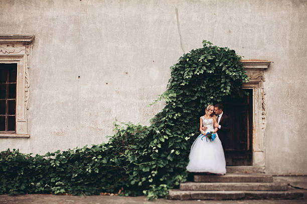 Happy wedding couple hugging and smiling each other on the stock photo