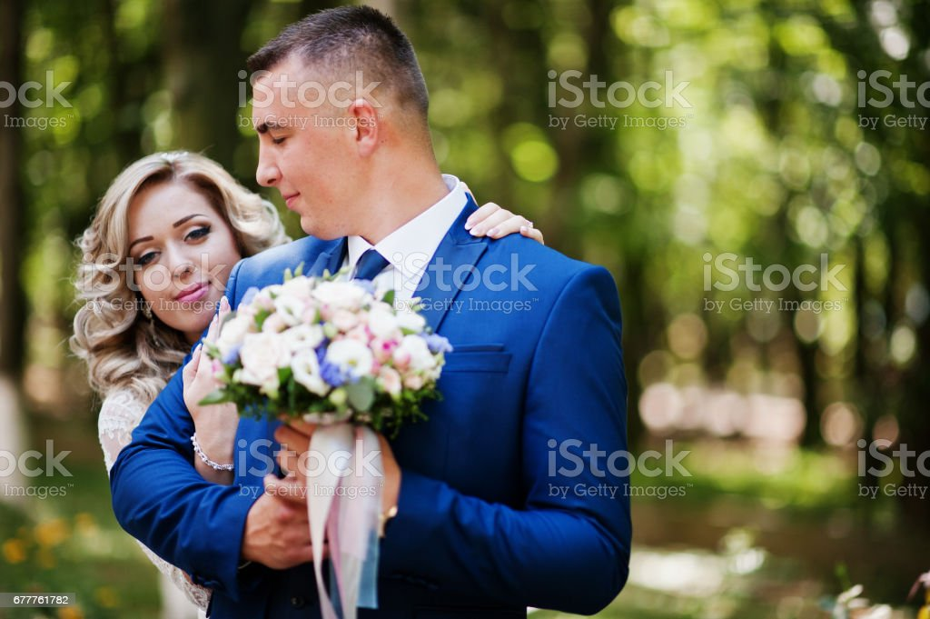 Happy wedding couple in love at park on sunny day. royalty-free stock photo