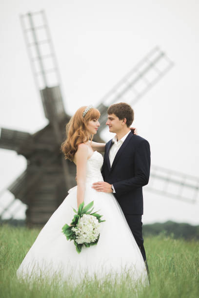 Happy wedding couple walking in a botanical park stock photo