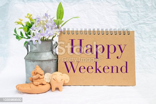 istock Happy Weekend card with elephants clay sculpture 1035989550