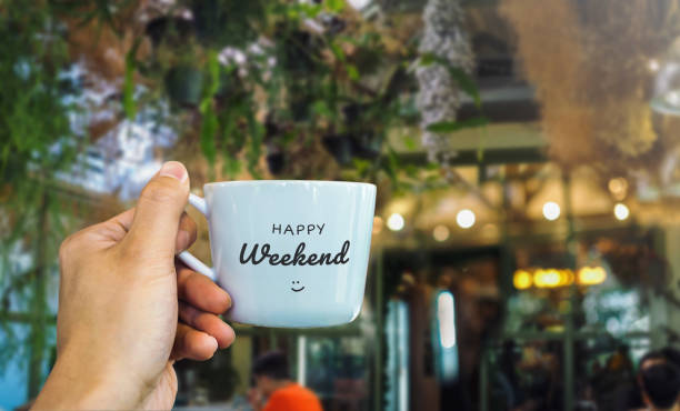 Happy weekend text on mug with cafe view Happy weekend text on mug with cafe view sunday stock pictures, royalty-free photos & images