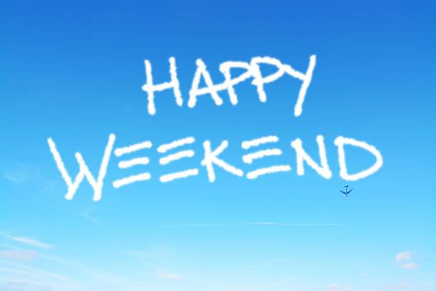 happy weekend schriftliche in the sky - schrift am himmel stock-fotos und bilder