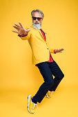 istock Happy well dressed gentleman having photoshooting in studio 1209650664