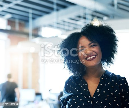 590241864istockphoto Happy when she's at work 872323894
