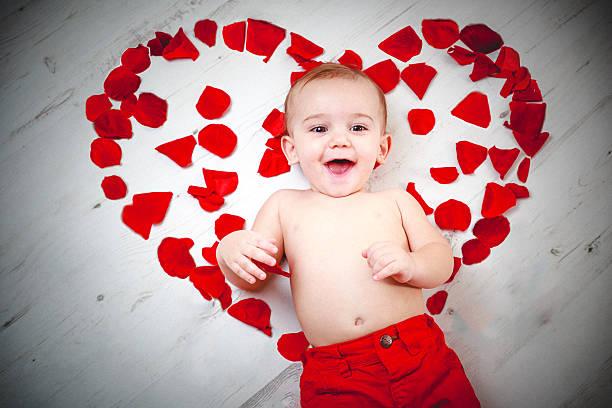 Happy white caucasian baby boy with rose petals forming heart picture id465852664?b=1&k=6&m=465852664&s=612x612&w=0&h=wpa9ecu nbu3v2kwzelsdq6 yd0 jmahhjf3ypaz85k=