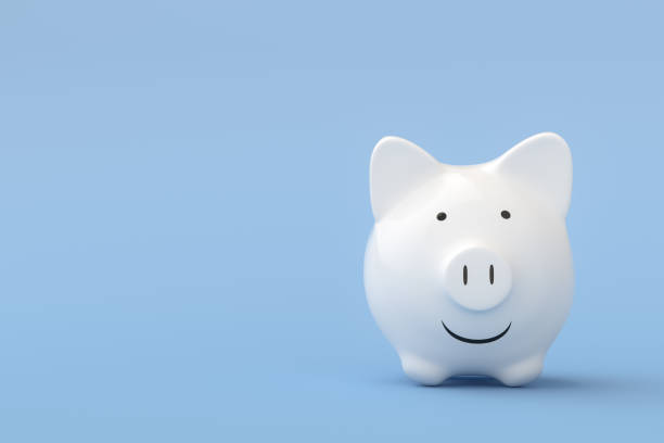 Happy White Piggy Bank on blue background stock photo