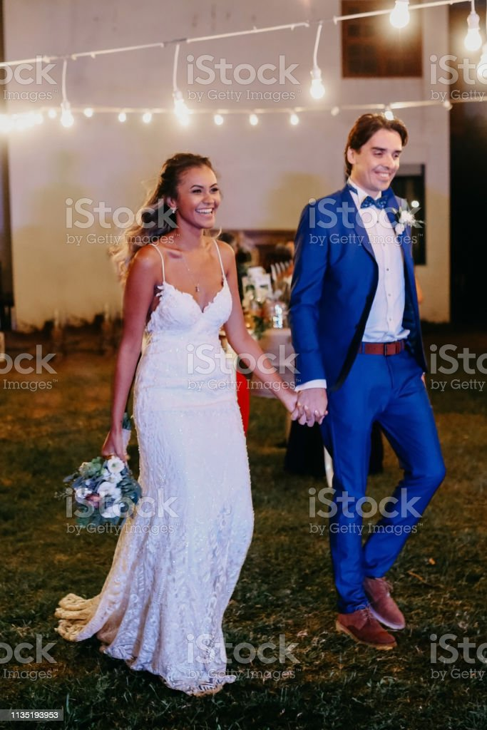 Happy Wife And Groom Dancing At Night Outdoors Wedding