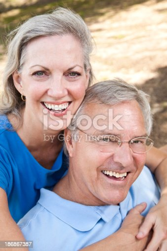 119998253 istock photo Happy Wife Hugging Her Husband From Behind 186867387