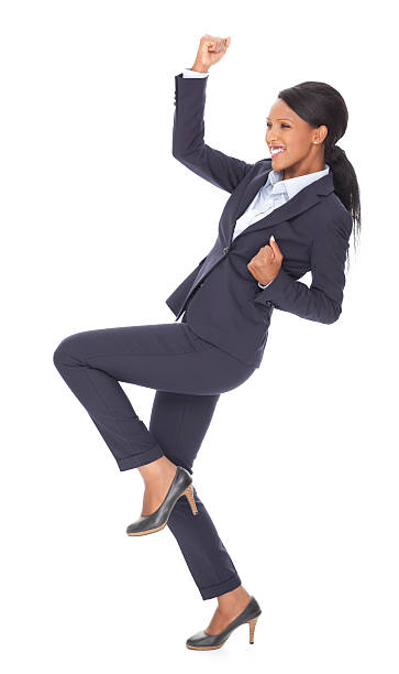 Happy winner business woman. Attractive businesswoman celebrating success. isolated on white background, cut out image. yeah right stock pictures, royalty-free photos & images