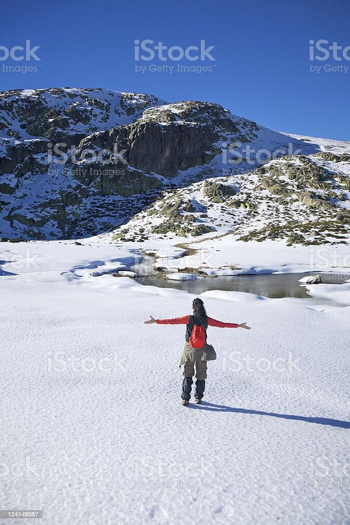 happy winter hiking woman on snow stock photo