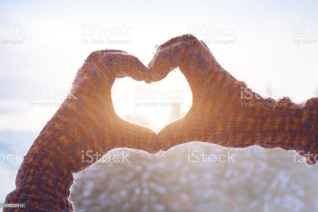 happy winter holidays, heart love sign from hands stock photo