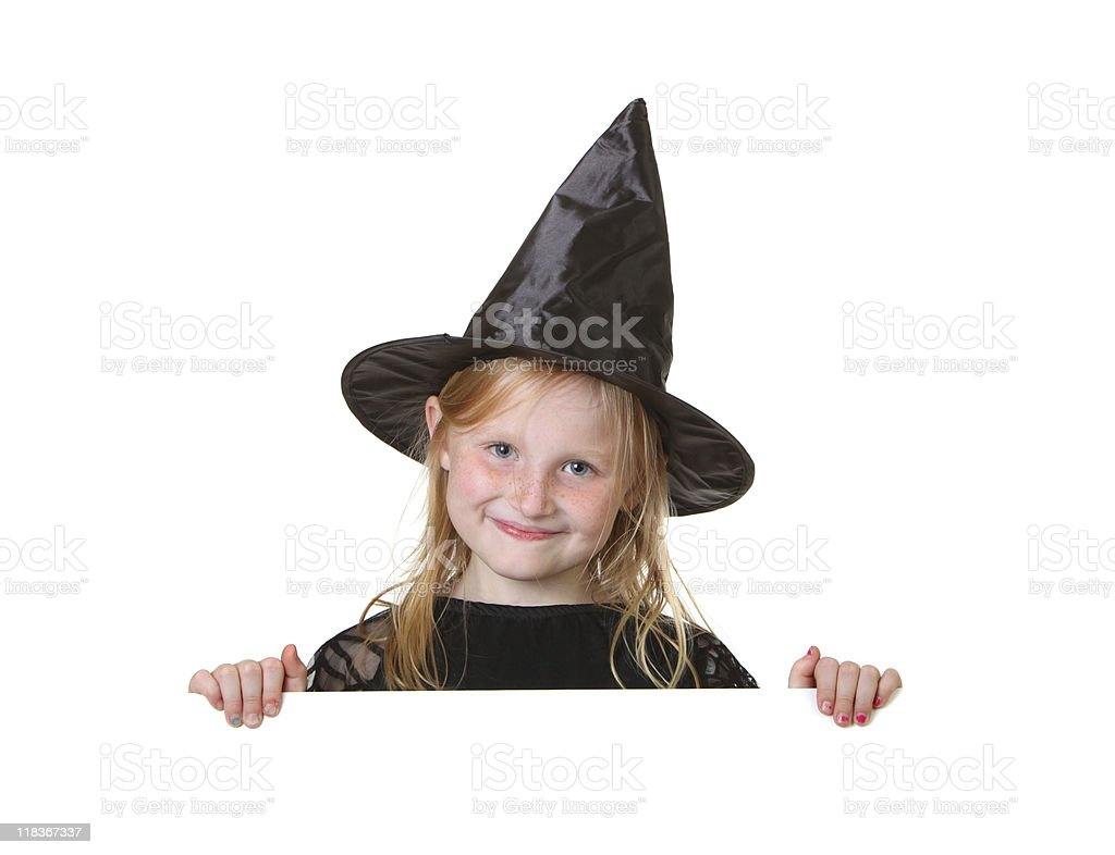 happy witch holding sign royalty-free stock photo