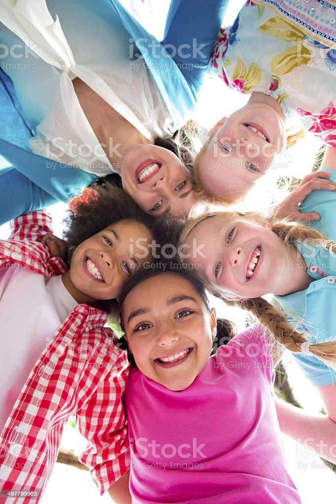 Happy with Heads Together Looking Down Smiling stock photo